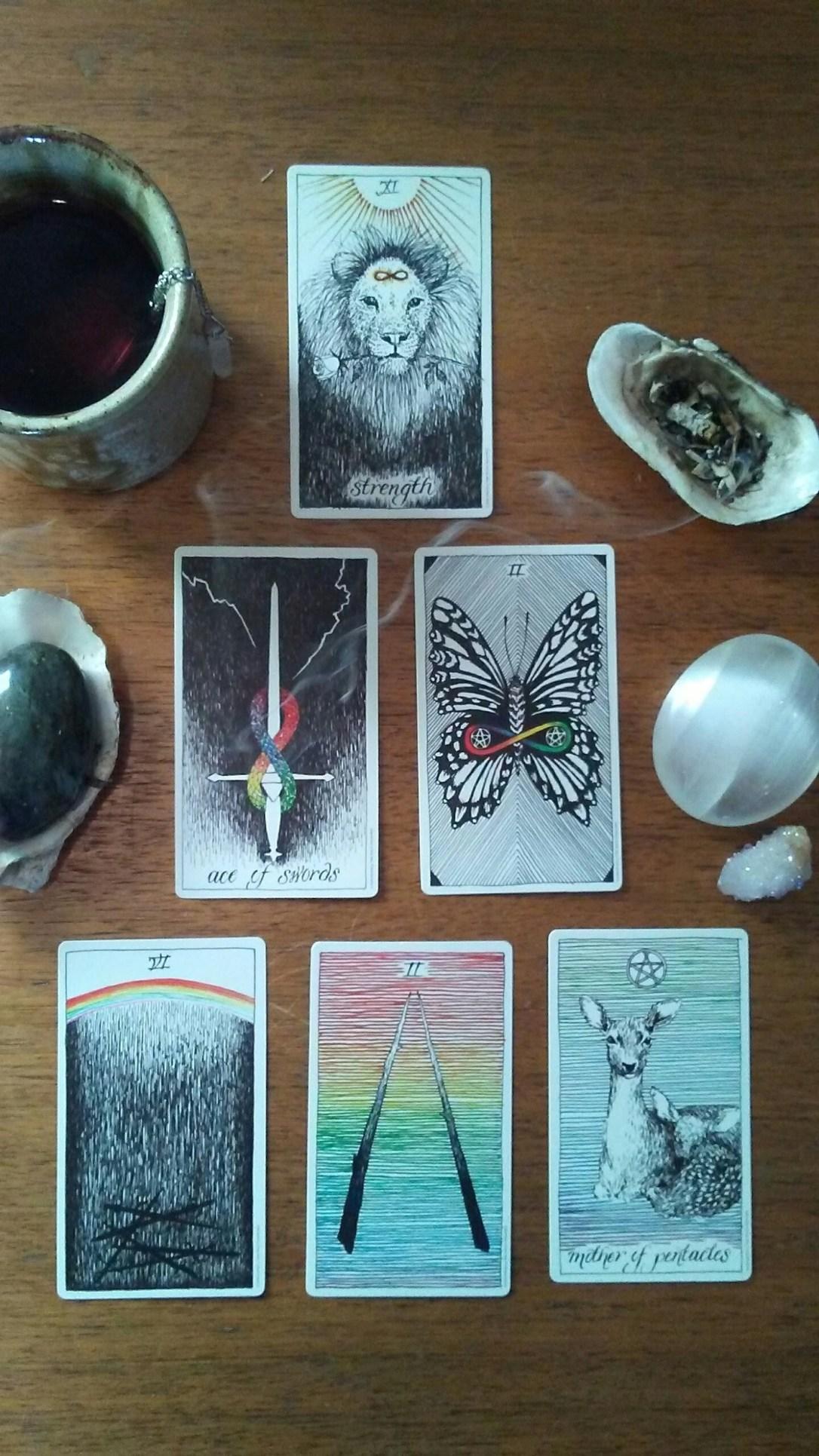 Tarot cards, incense, tea, crystals, shells