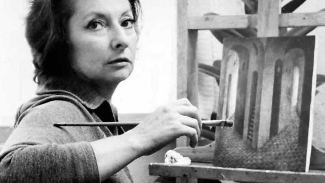 Remedios Varo painting in her studio