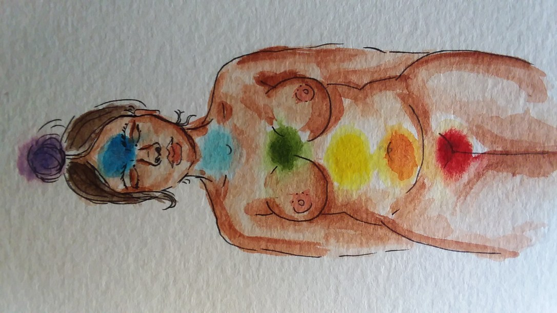 watercolor painting of a nude woman with colorful chakras