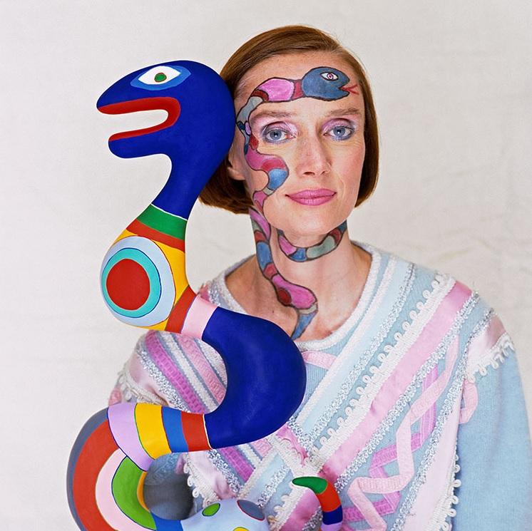 artist niki de saint phalle holding a snake sculpture