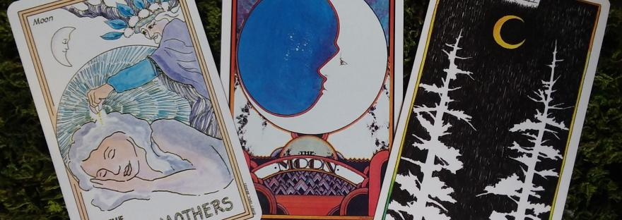 tarot cards featuring the moon with crystal stone