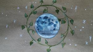 watercolor painting of the moon surrounded by ivy and stars
