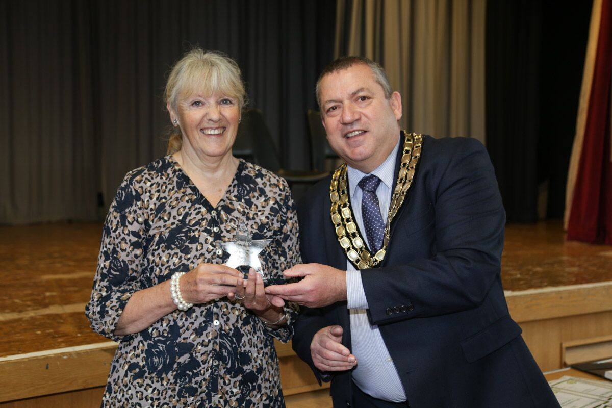 Sylvia Welsh receiving her award from Cllr Stan Hebborn, Mayor of Watton