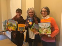 Board members Lauren Montanaro and Carole Thompson and Outreach Committee Chair Diane Seligman with boosk donated by Wayland Creative Playschool