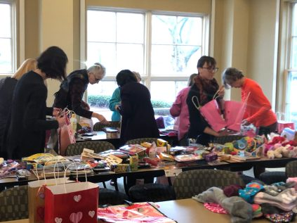 Roundtable members fill Valentine gift bags for shelter families