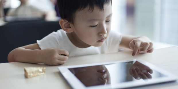 child using tablet PC in classroom