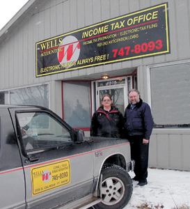 Connie Wells and her husband Al in front of their new accounting business in Waynedale at 2505 Lower Huntington Road. Al owns Wells Auctioneering and drives bus for PTC. Connie employs eight people during tax season and hopes to continue to grow her business to other areas of town.