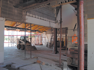 Photo by Cindy Cornwell - Bobcat & Scissor Lift aid in the reconstruction of the Waynedale Branch Library.