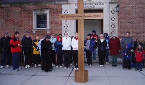 photo by Corissa Baker The Jubilee Pilgrim Cross traveled downtown to the abortion clinic on February 9, 2006 where students from Bishop Luers and Bishop Dwenger High Schools as well as St. Therese Catholic School and Father Joe Rulli peacefully prayed for the women and their babies.