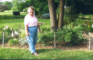 "Barb Gibson takes her ""Garden Walk"" around Winterset subdivision in Waynedale."