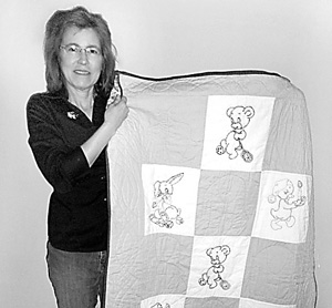 Kathy Wilson with her Christmas elephant quilt.