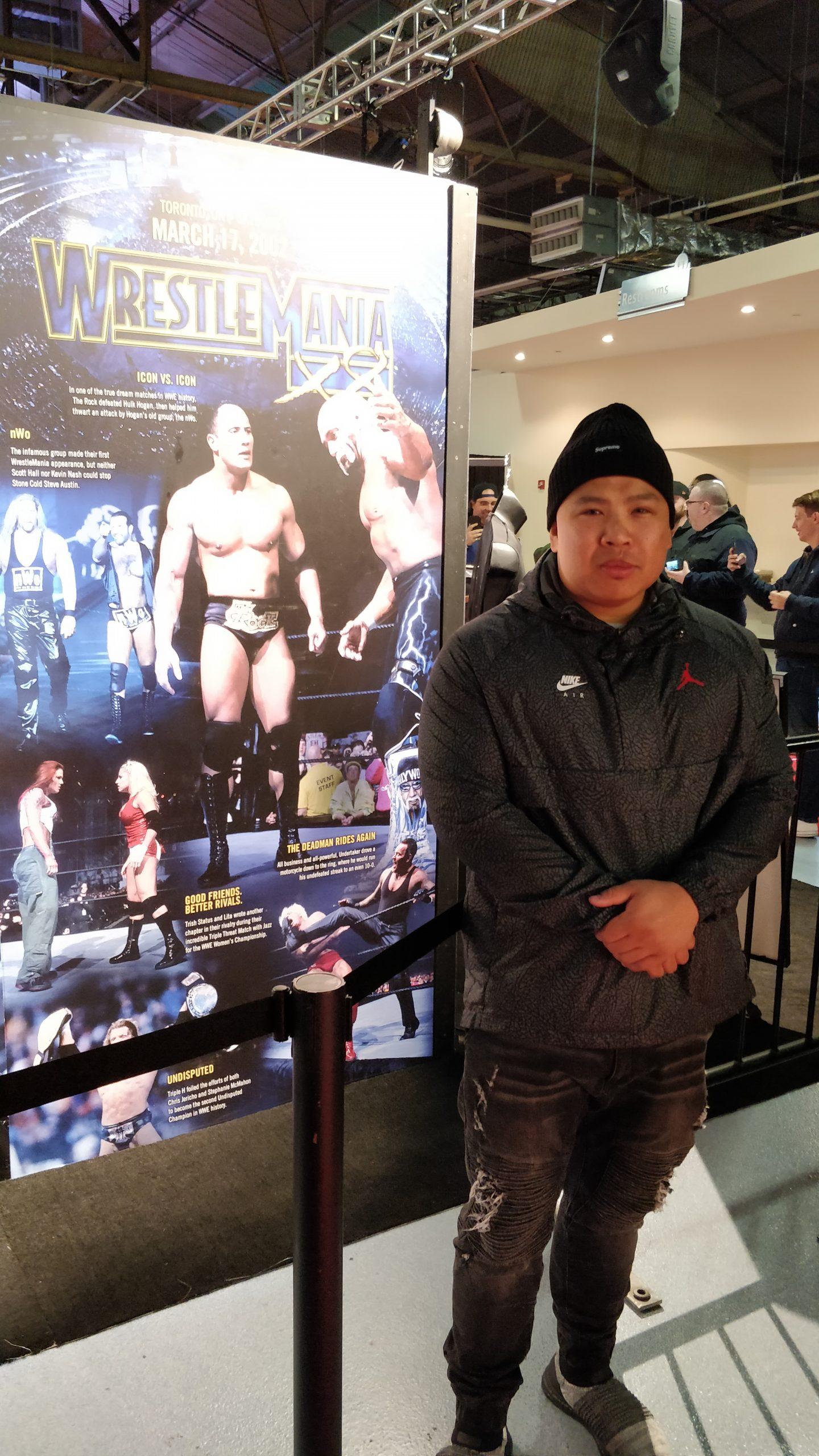 Wayne Lapasa standing next to the WrestleMania X8 Exhibit at WrestleMania Axxess