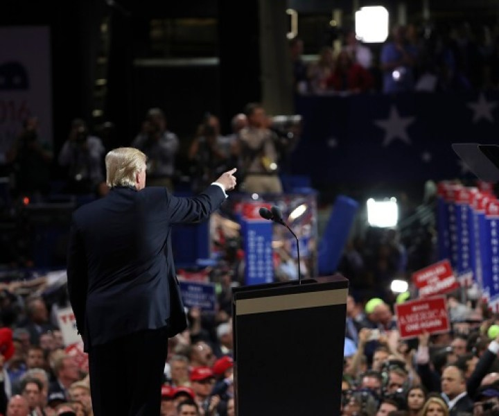 Donald Trump points to his vice presidential nominee, Mike Pence, on the final night of the Republican National Convention, at the Quicken Loans Arena in Cleveland, July 21, 2016. (Stephen Crowley/The New York Times)