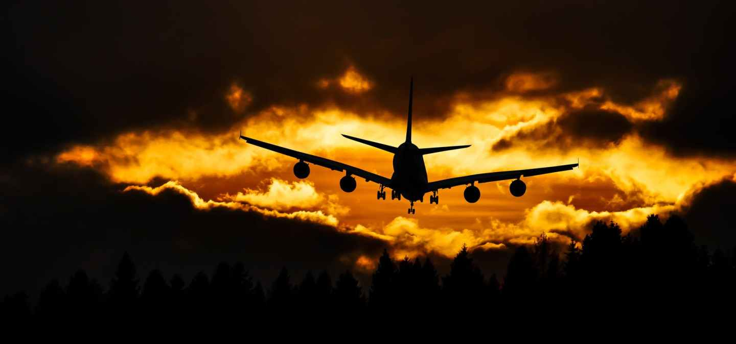 airplane silhouette on air during sunset