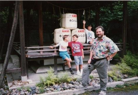 Guys with sake kegs