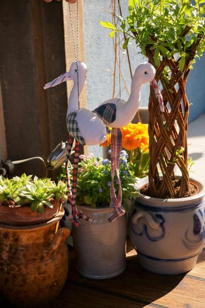 Wayome upcycling des cigognes qui se balancent soleil milieu