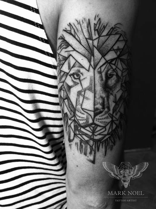 tattoo idea for lion on arm by Mark Noel