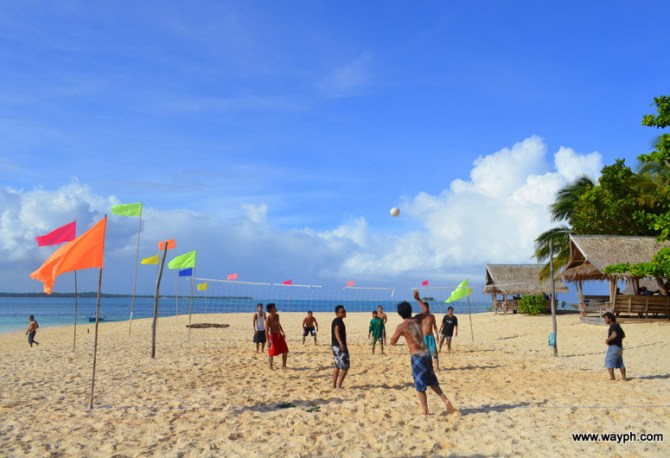 Local playing volleyball in dako Island
