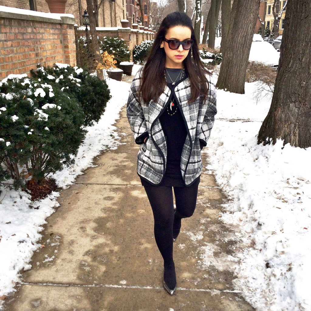 A classic winter look wearing all black and a classic cape