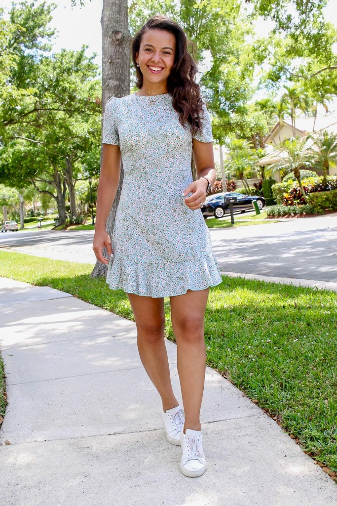 white sneakers with a summer floral dress