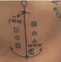 coordinates of Maya Bay tattooed on my ribs.