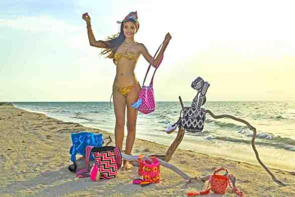 Wayuu beach bags crochet pattern wayuu bags on the beach displayed by a model in la guajira colombia