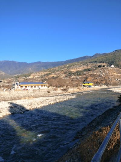 Walking by the Paro Chhu River in Paro, Bhutan
