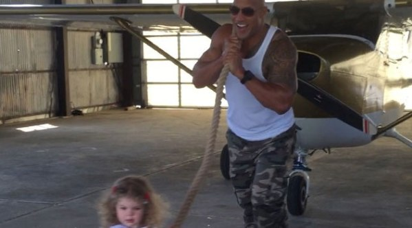 Toddler pulling a plane all by herself – The Rock