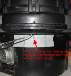 step 2 put a piece of masking tape on the lower housing item 1 in the service manual and mark the position of the rotor with the alignment marks on the  [ 1200 x 674 Pixel ]