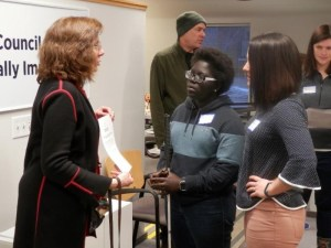Council Board Member Patty Zallar talking with scholarship recipient Mikeyla Mobley and Naomi Behm Hrdina, teacher of the visually impaired with the Madison Metropolitan School District, about guide dog use and advocacy.