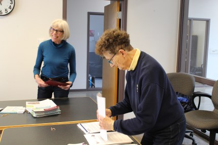Photo of Karen Lee Weidig and Margaret Sommers stuffing folders for the Council's Legislative Day.