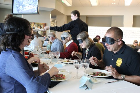 Diners enjoy food that was prepared and served by students in the culinary program at Madison College.
