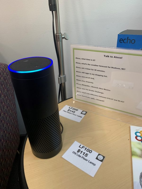 An Amazon Echo sits on a table