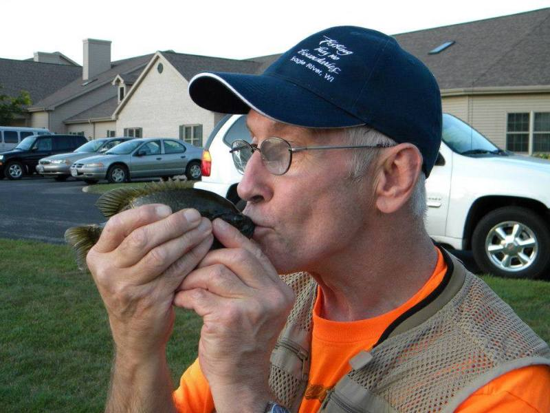 Man kissing fish