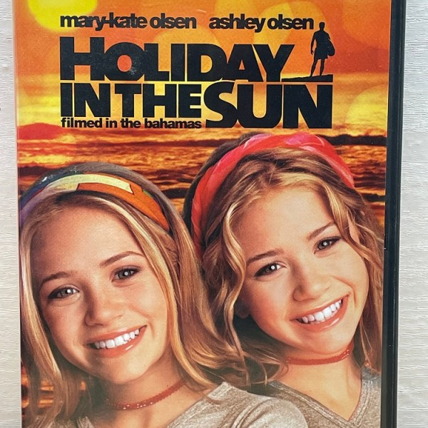 Holiday In The Sun Cert (U) Used VG