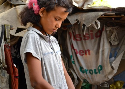 We gave a food bag to this young girl who lives on the River bed.