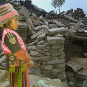 """This young girl lost her sister in the quake.  Here she is showing Raju the remains of her house """"where she used to play with her small sister who died that day..."""""""