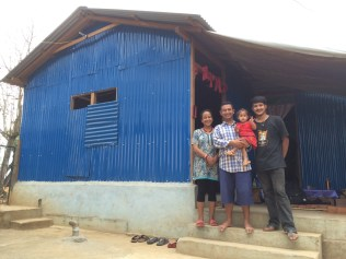 Pastor Uddav and family outside their home at Chhampi Vineyard