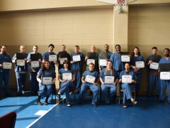 The Windows to Work graduates pose with their diplomas.