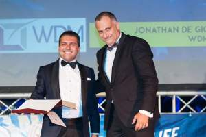 Dr. Jonathan De Giovanni being presented the award by the CEO of Agri Bank, Mr. Roderick Psaila.