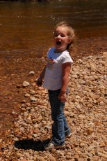 Proclaiming to all the rocks that she will throw them in the water!