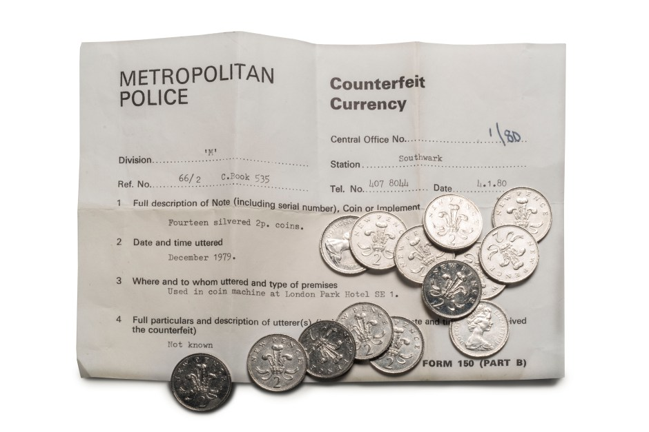 Fourteen counterfeit silvered 2p coins, 1979, recovered by the Metropolitan Police. © Museum of London / object courtesy the Metropolitan Police's Crime Museum