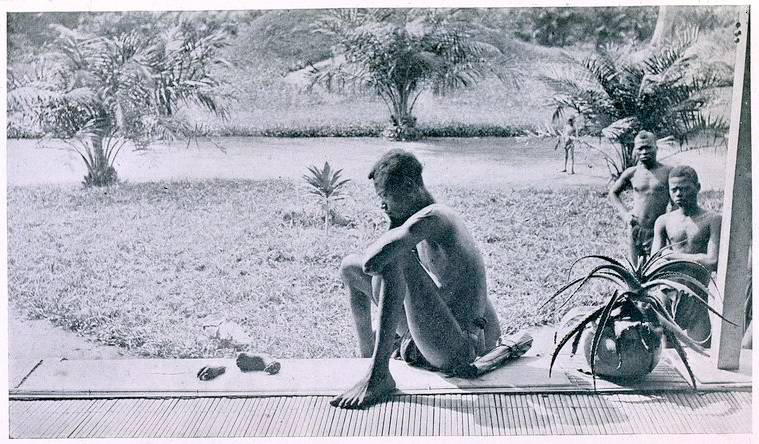 Nsala_of_Wala_in_Congo_looks_at_the_severed_hand_and_foot_of_his_five-year_old_daughter,_1904