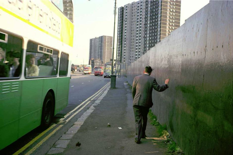 852602-man-reeling-and-green-bus-photo-raymond-depardon-magnum
