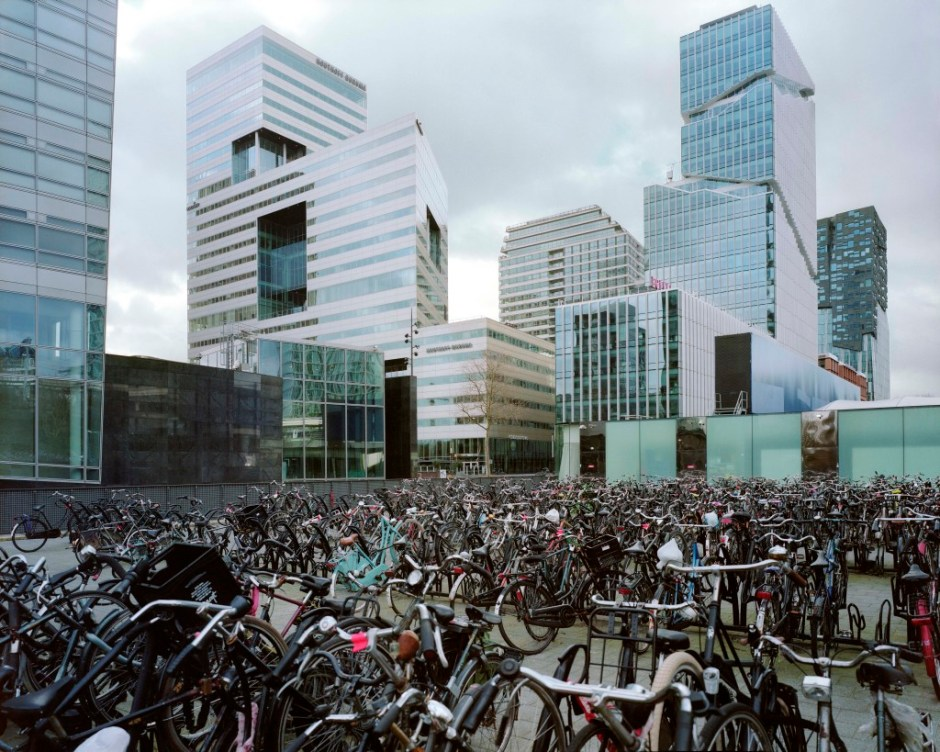 Bicycle parking lot in Zuid, a growing financial center on the edge of the city of Amsterdam where thousands of empty mailbox companies used to avoid tax are located.  The Netherlands is one of the biggest enablers of aggressive corporate tax avoidance and has built a booming industry around promoting and selling Dutch tax services to global companies.  According to many specialists, the Netherlands – which has a suite of offerings to cut corporate taxes on, among others, interest, royalties, dividend and capital gains income from foreign subsidiaries,  – is a tax haven. The Netherlands.