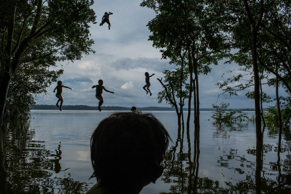 1. Tapajós River, Itaituba, Pará State, Brazil, on February 10, 2015. Indigenous children jump into the water as they play around the Tapajós river, in the Munduruku tribal area called Sawré Muybu.