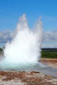 The Strokkur geyser starting to explode in Geysir in Iceland