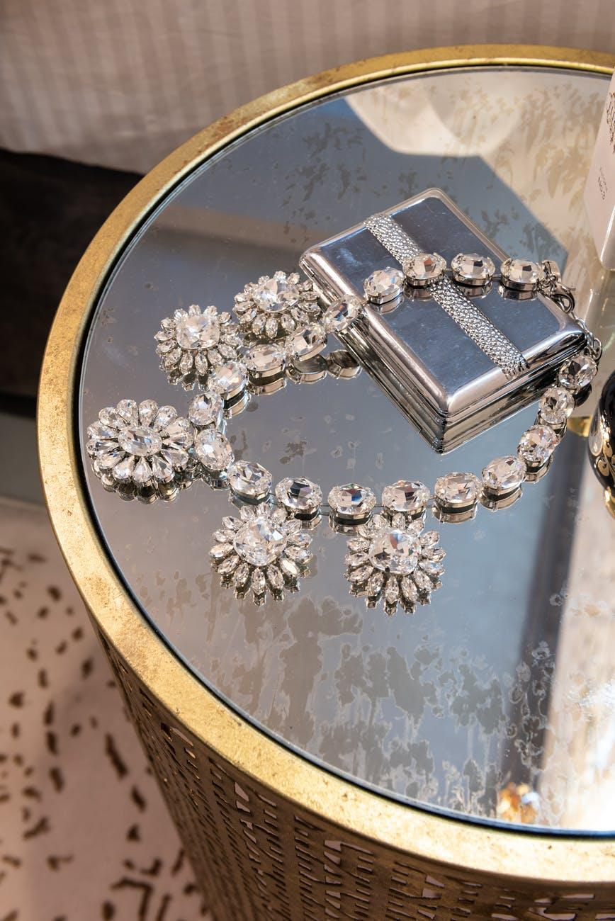 necklace with decor on jewelry box at home
