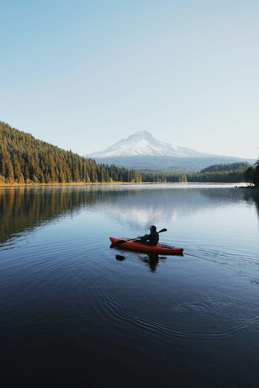 person riding kayak