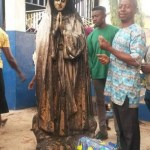 shocking incident : Woman burnt statue of Virgin Mary ablaze at a Catholic Church in Enugu (Photo)